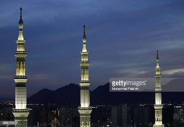 The minarets of the Prophet Muhammad mosque are lit up on January 19 2006 in the holy city of Medina Saudi Arabia Saudi authorities are turning...