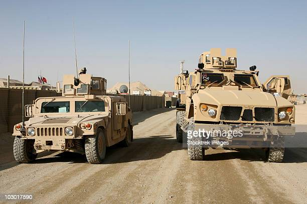 the mine resistant ambush protected all terrain vehicle and its predecessor, the humvee. - mine resistant ambush protected stock pictures, royalty-free photos & images
