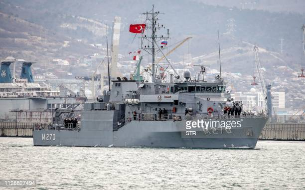 The minesweeper Akcay of the Naval Forces of Turkey enters the harbour of the Russian port of Novorossiysk on March 6, 2019. - Two Turkish warships...