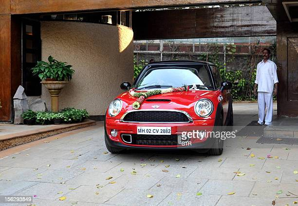 The 'Mini Cooper S' motor car gifted by Indian Bollywood film actor Abhishek Bachchan to his daughter Aaradhya is driven by her grandfather and film...