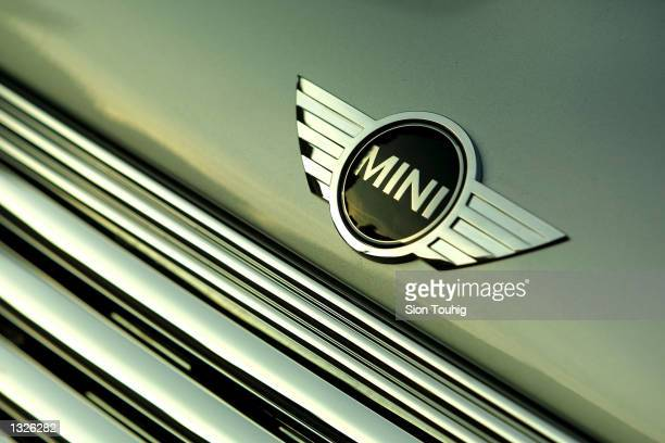 The Mini logos marks the hood of a new Mini Cooper car June 25 2001 in London England as the new model is unveiled to the auto industry press The...