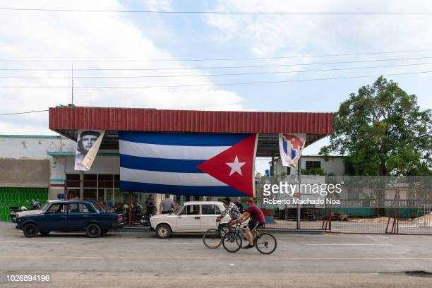 The MININT gas station displaying a large Cuban flag during the holidays of July 26 Law enforcement vehicles use an exclusive gas station