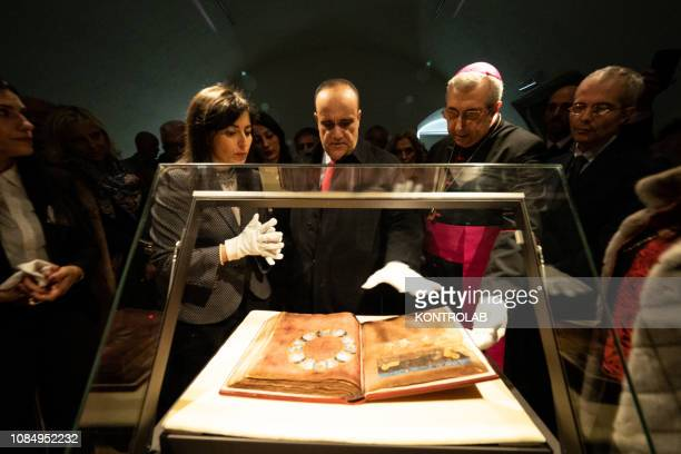 The Minister for Cultural Heritage Alberto Bonisoli looks at the Codex Purpureus during his visit to Rossano to see and leaf through the Greek...