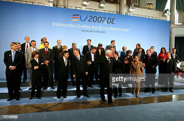 The Minister for Foreign Affairs of the 27 European Union nations pose for a photo around German Minister for Foreign Affairs FrankWalter Steinmeier...