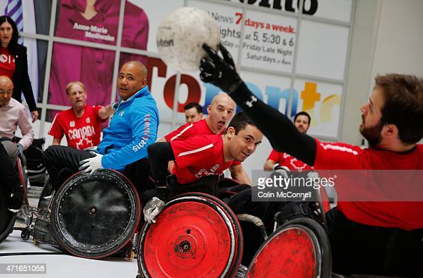 The Minister Michael Coteau,in blue participates with the athletes... Launch event held at the CBC on Front St for the 100 days to ParaPan with...