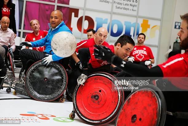 The Minister, Michael Coteau,in blue participates with the athletes... Launch event held at the CBC on Front St for the 100 days to ParaPan with...