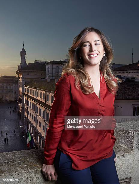 The Minister of Constitutional Reforms and Relations with Parliament of the Italian Republic Maria Elena Boschi smiling on the balcony of her office...