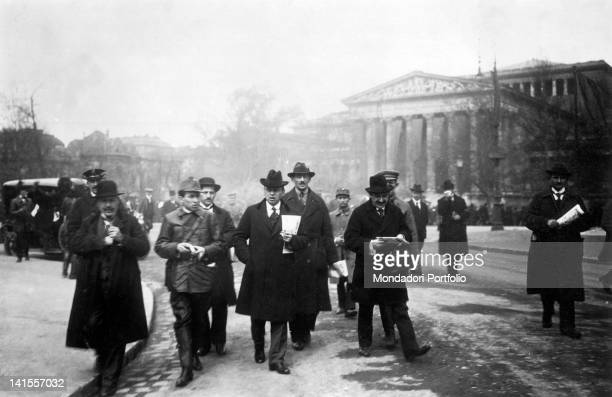 The Minister of Foreign Affairs and leader of the Hungarian Soviet Republic Bela Kun walking along a street with other members of the government...