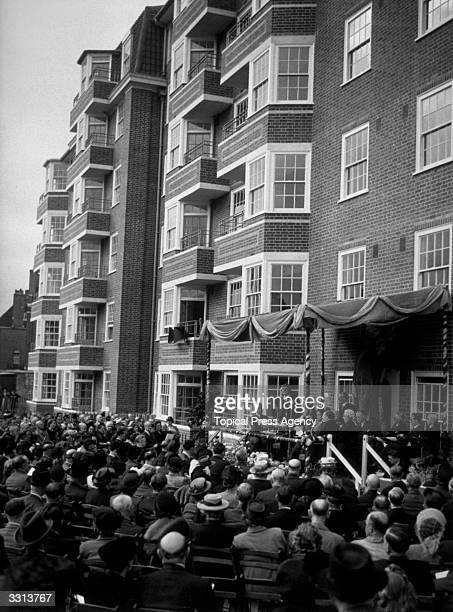 The Minister of Health, Mr Aneurin Bevan, opening a new block of flats, at Aspen Gardens, Hammersmith, London.