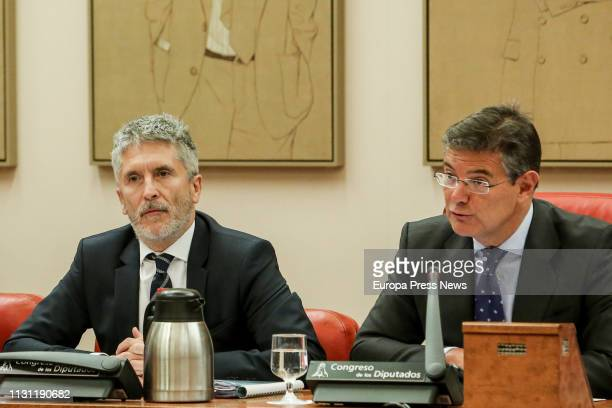 The minister of Interior Fernando GrandeMarlaska and the president of the Commission Rafael Catala are seen during the Interior Commission at the...