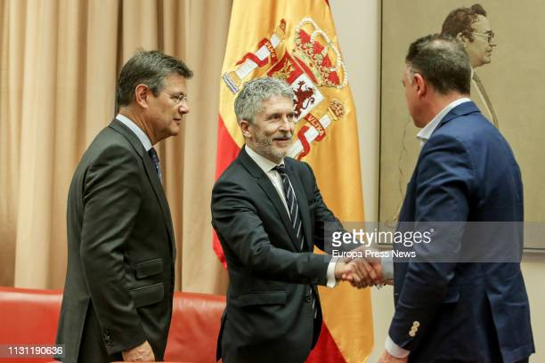 The minister of Interior Fernando GrandeMarlaska the president of the Commission Rafael Catala and the first secretary of the Commission Juan Antonio...