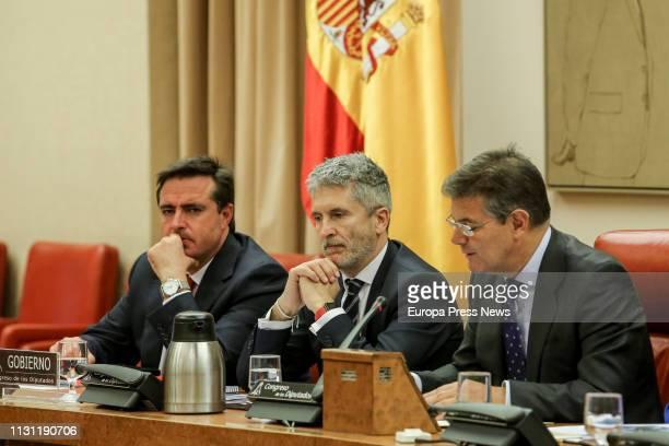 The minister of Interior Fernando GrandeMarlaska the president of the Commission Rafael Catala and the first vice president of the Commission Henrick...