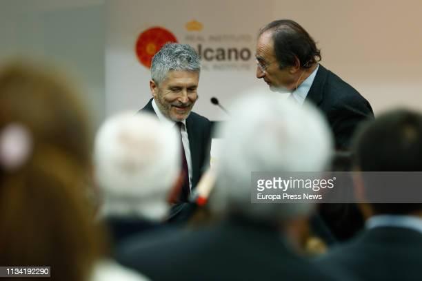 The minister of Internal Affairs minister Fernando GrandeMarlaska and the president of the Real Instituto Elcano Emilio Lamo de Espinosa are seen...