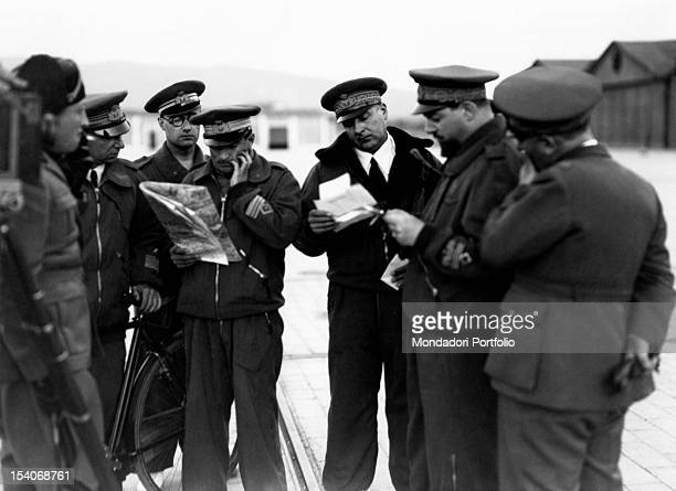 The Minister of Italian Royal Air Force Italo Balbo reading documents with some officers of the Italian army 1930s