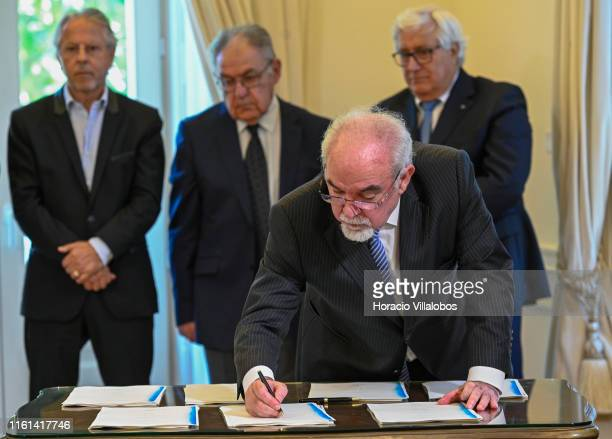 The Minister of Labor, Solidarity and Social Security José António Vieira da Silva signs the protocols during the signature with representatives of...