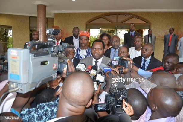 The Minister of Relations with Public Institutions and Political Reform Arsene Bongnessan Ye speaks to journalists on August 23 in Ouagadougou after...