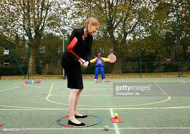 The Minister of Sport Tracey Crouch aims at a target man as she takes part in Snag Golf as she visits the Sports Pavillion at The Hyde to Unveil New...