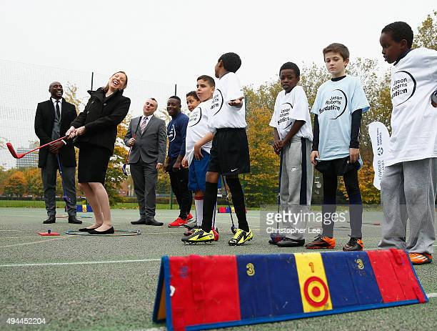 The Minister of Sport Tracey Crouch takes aim at a target as she takes part in Snag Golf with the Sport England Director of Community Sport Mike...