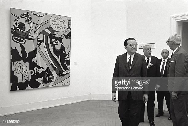 The ministry Giulio Andreotti is visiting the art exhibition at the Biennale di Venezia at his right a painting of Roy Lichtenstein Venice 1966