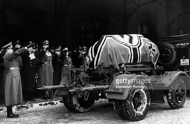 The Ministry of the Armaments Albert Speer and other Nazi authorities tributing the coffin of Fritz Todt wrapped with the Nazi flag on a gun Berlin...
