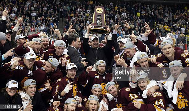The Minnesota Duluth Bulldogs celebrate with the trophy after they defeated the Michigan Wolverines after the championship game of the 2011 NCAA...