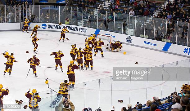 The Minnesota Golden Gophers celebrate after winning the 2016 NCAA Division I Women's Hockey Frozen Four Championship against the Boston College...