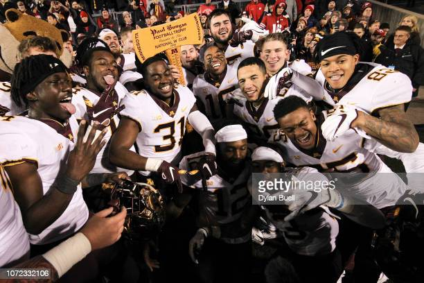 The Minnesota Golden Gophers celebrate with Paul Bunyan's Axe after beating the Wisconsin Badgers 3715 at Camp Randall Stadium on November 24 2018 in...