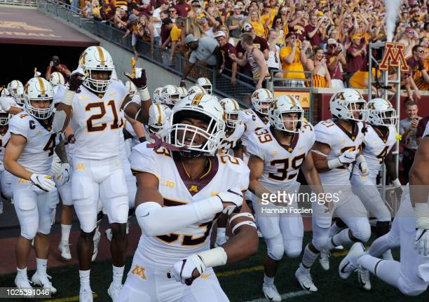 The Minnesota Golden Gophers run onto the field before the game against the New Mexico State Aggies on August 30, 2018 at TCF Bank Stadium in...