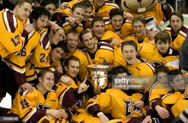 The Minnesota Gophers celebrate with the McNaughton Cup after the victory against Michigan Tech on March 2 2007 at Mariuccci Arena in Minneapolis...