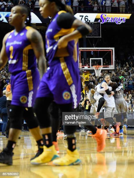 The Minnesota Lynx celebrate winning as the Los Angeles Sparks walk off the court after Game Five of the WNBA Finals on October 4 2017 at Williams in...