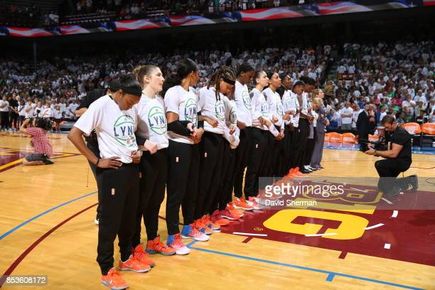 The Minnesota Lynx lock arms for the national anthem before the game against the Los Angeles Sparks in Game One of the 2017 WNBA Finals on September...