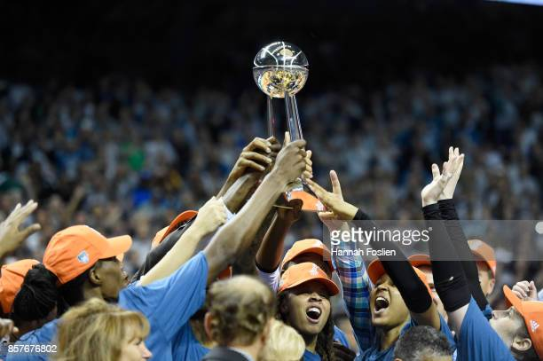 The Minnesota Lynx raise the Championship trophy after defeating the Los Angeles Sparks in Game Five of the WNBA Finals on October 4 2017 at Williams...