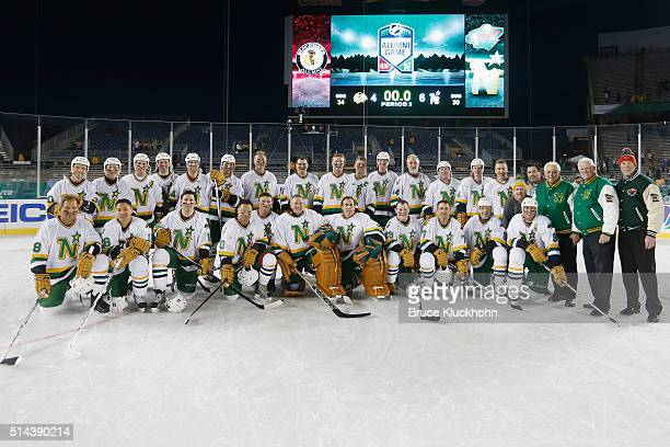 The Minnesota North Stars/Wild pose for a team photo after defeating the Chicago Blackhawks in the Coors Light NHL Stadium Series Alumni game on...