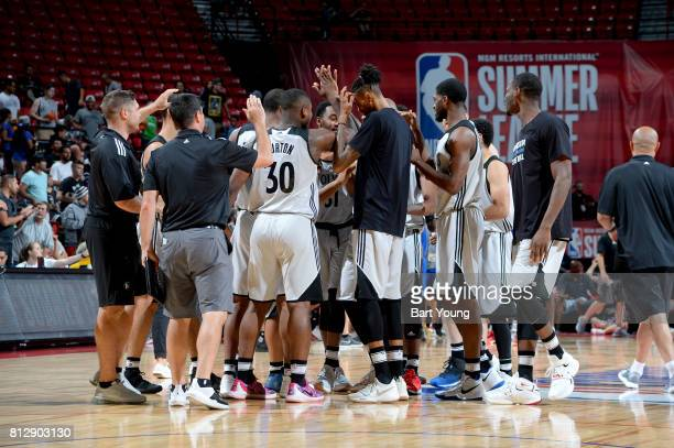 The Minnesota Timberwolves celebrate after CJ Williams of the Minnesota Timberwolves scores a basket to win the game against the Golden State...