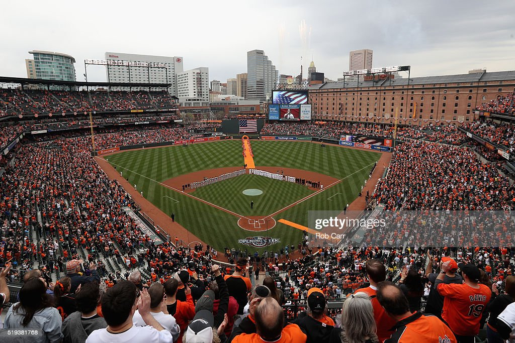 The Minnesota Twins and Baltimore Orioles stand on the field during the national anthem before the start of their Opening Day game at Oriole Park at Camden Yards on April 4, 2016 in Baltimore, Maryland.