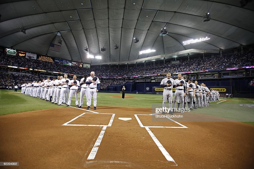The Minnesota Twins and the New York Yankees line up for the national anthem, sung by Rachel York, prior to the game on October 11, 2009 at the Metrodome in Minneapolis, Minnesota. The New York Yankees won game 3 of the American League Division Series 4-1.
