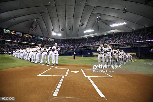 The Minnesota Twins and the New York Yankees line up for the national anthem sung by Rachel York prior to the game on October 11 2009 at the...