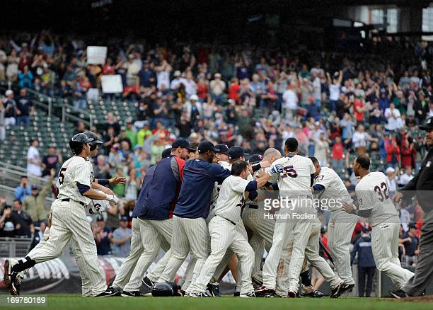The Minnesota Twins celebrate a walk off win of the game against the Seattle Mariners on June 1 2013 at Target Field in Minneapolis Minnesota The...