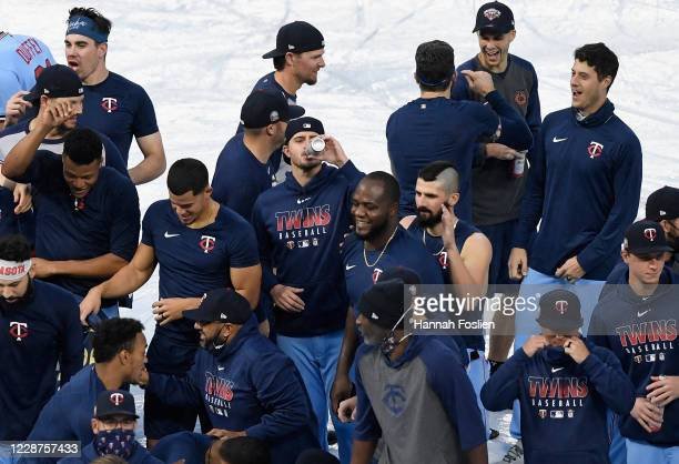 The Minnesota Twins celebrate being the American League Central Division Champions after the game against the Cincinnati Reds at Target Field on...