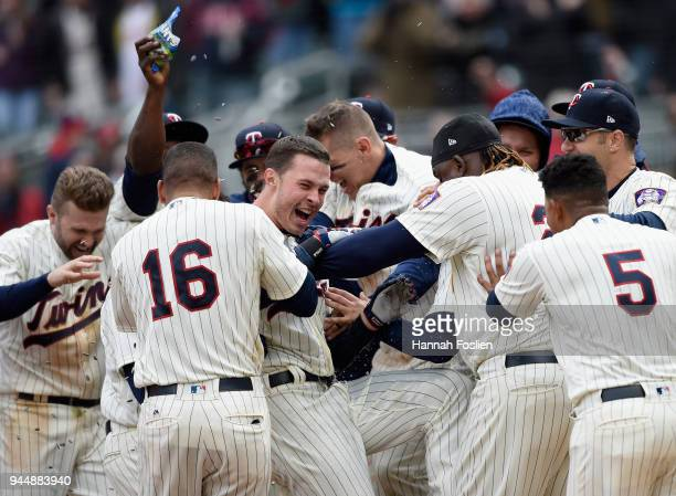The Minnesota Twins congratulate Max Kepler on a solo walkoff home run against the Houston Astros during the ninth inning of the game on April 11...