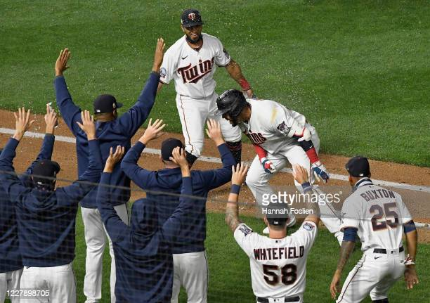 The Minnesota Twins congratulate Nelson Cruz on a walkoff double against the Pittsburgh Pirates during the ninth inning of the game at Target Field...