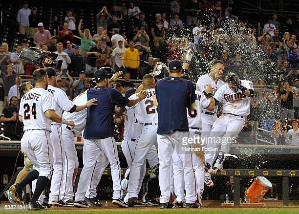 The Minnesota Twins congratulate teammate Brian Dozier on a tworun walkoff home run against the Miami Marlins during the eleventh inning of the game...