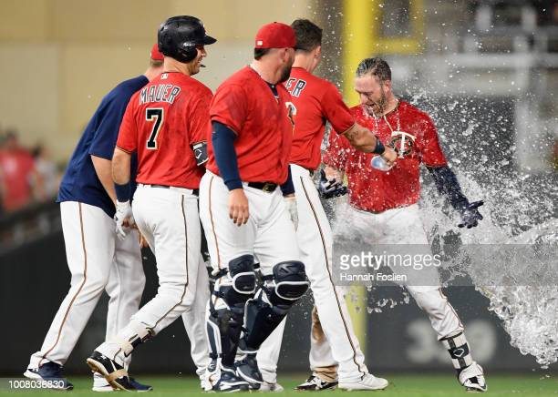 The Minnesota Twins congratulate teammate Mitch Garver on hitting a walkoff double against the Cleveland Indians during the ninth inning of the game...