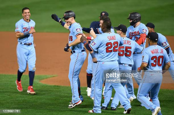 The Minnesota Twins congratulates Max Kepler on a walkoff single against the Detroit Tigers during the tenth inning of the game at Target Field on...