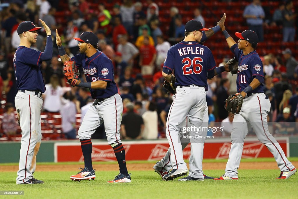 The Minnesota Twins high five each other after their victory over the Boston Red Sox at Fenway Park on June 28, 2017 in Boston, Massachusetts.