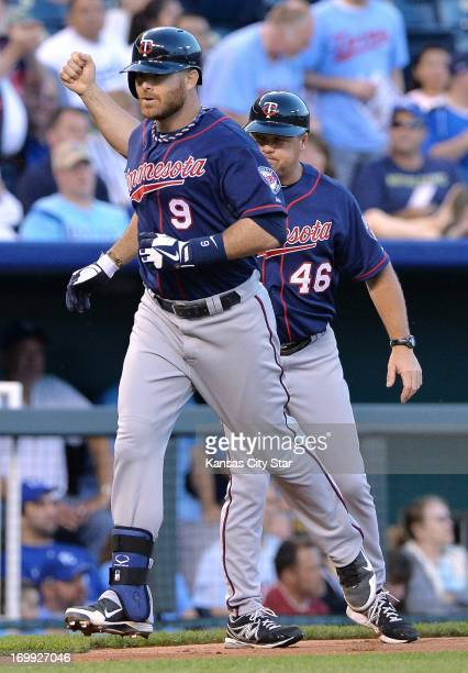 The Minnesota Twins' Ryan Doumit is congratulated by third base coach Joe Vavra after hitting a solo home run in the fourth inning against the Kansas...