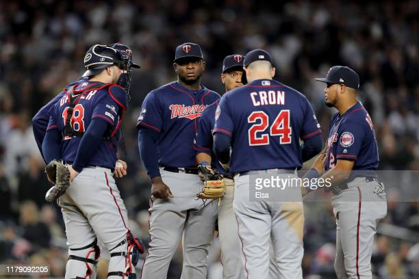 The Minnesota Twins talk on the mound against the New York Yankees during the fifth inning in game one of the American League Division Series at...