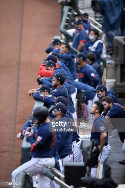 The Minnesota Twins watch from the dugout during the ninth inning of Game Two in the American League Wild Card Round against the Houston Astros at...