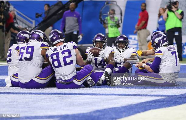 The Minnesota Vikings celebrate a touchdown by quarterback Case Keenum of the Minnesota Vikings during the first half at Ford Field on November 23...