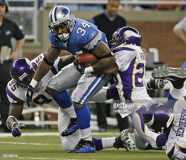 The Minnesota Vikings defense Kenechi Udee and Antoine Winfield help hold the Detroit Lions offense to minus3yards rushing at Ford Field Detroit...